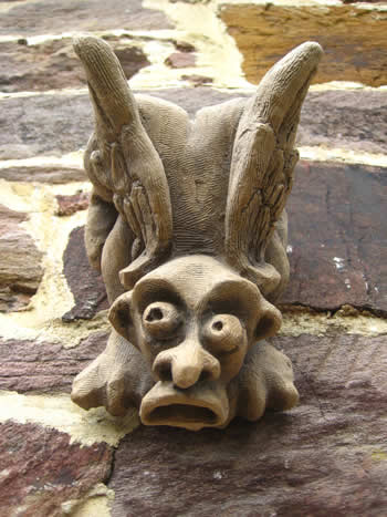 Winged Goggle Staue For Garden Wall Dark