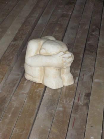 Crouching Man On Wood Pale